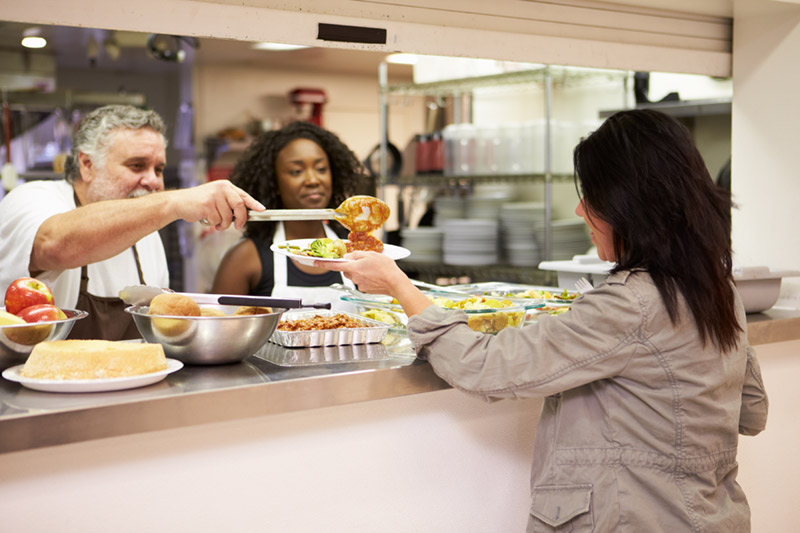 woman being served food