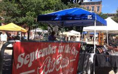 red banner of September in the City Art Fair in front of vendor booths
