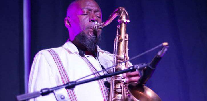 a man playing a saxaphone