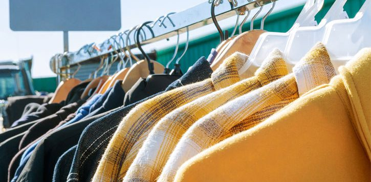 close up of winter coats on a rack
