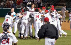 ValleyCats players join together on the field in victory