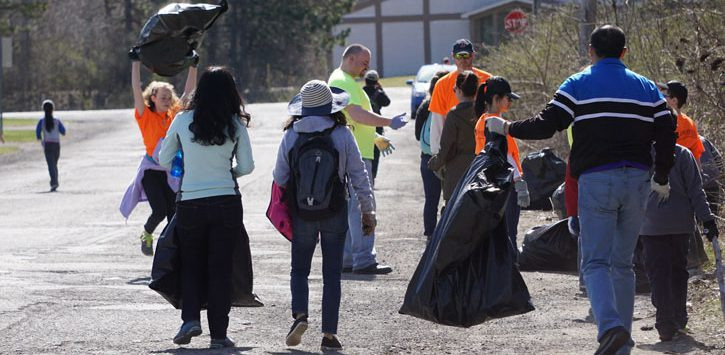 group of people picking up trash