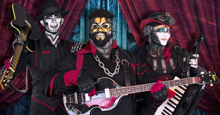 three costumed people with instruments