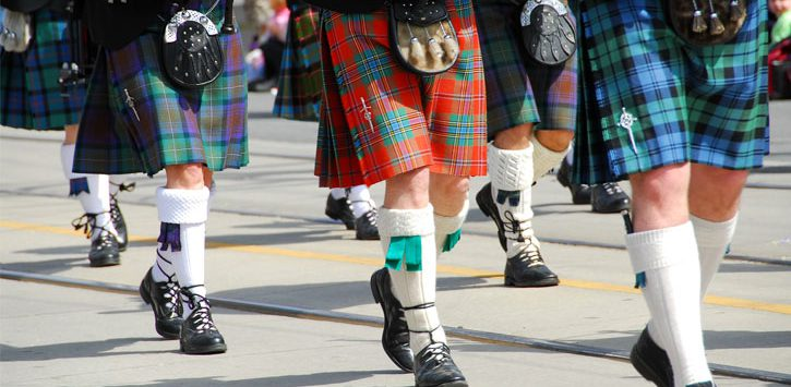 close up of babpipers marching