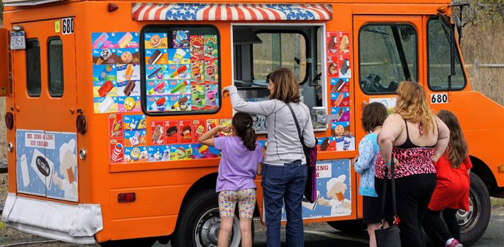women with kids at an ice cream truck