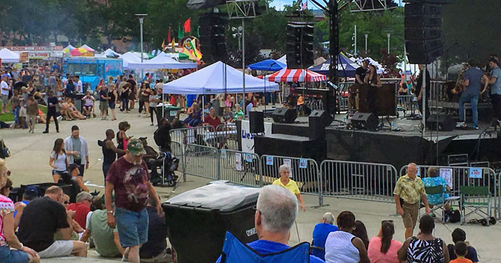 crowd at music performers setting up at Troy Pig Out