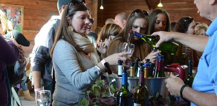 a woman at a wine tasting