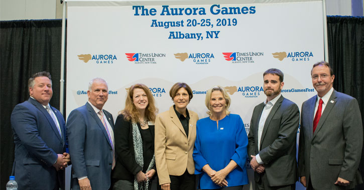 group of people in front of Aurora Games banner