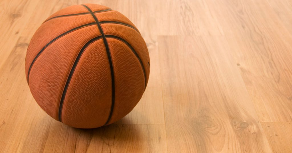 a basketball on a wood floor