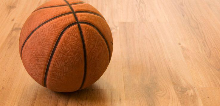 a basketball on a wood floor