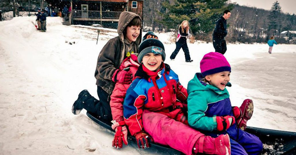 four kids sledding