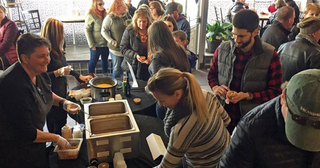 people at a soup sampling event