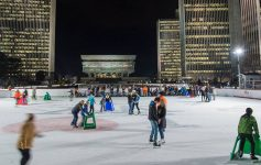 people ice skating at night