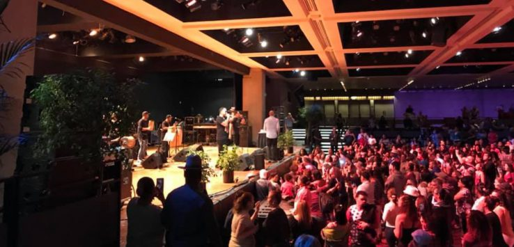 indoor concert with people near stage