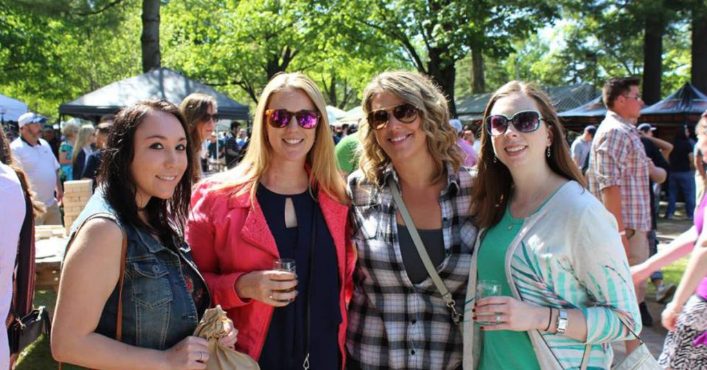 four women at a craft brew fest