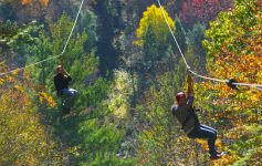 two people ziplining at catamount