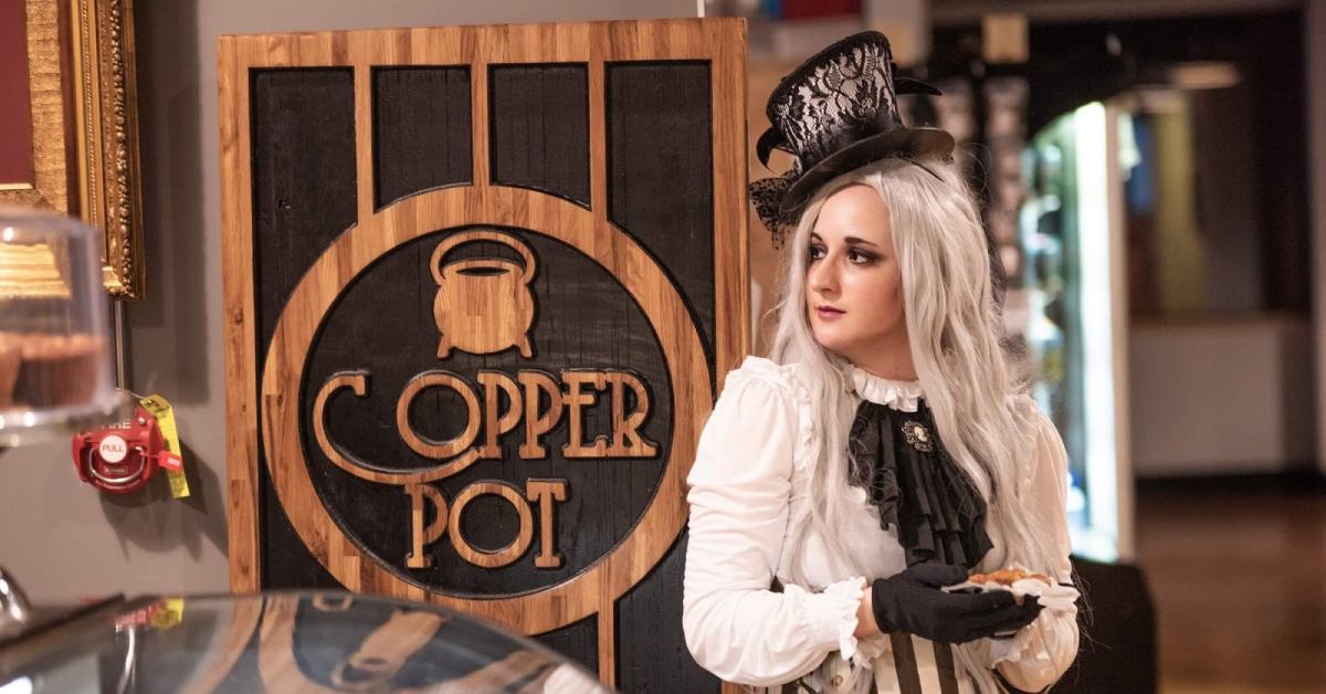 a woman dressed in steampunk attire at the copper pot
