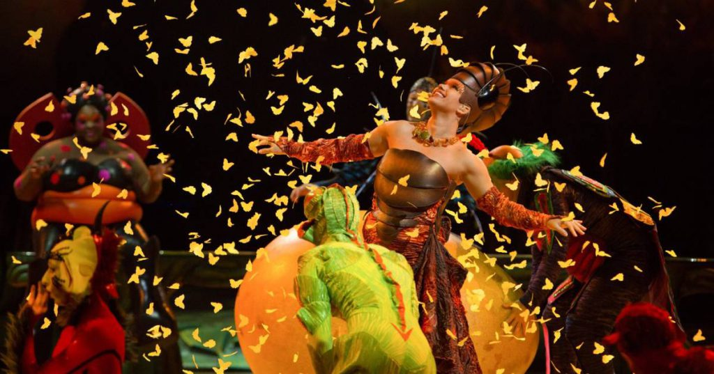 two women in insect costumes for a show