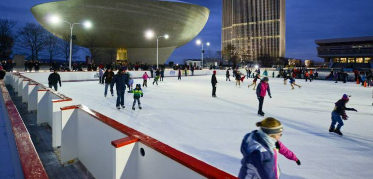 people ice skating on outdoor rink