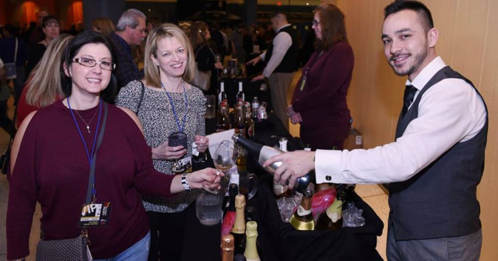 two people wine tasting