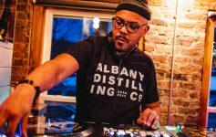 man at a DJ machine