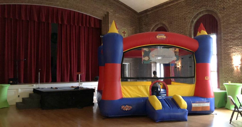 boy in a bounce house indoors