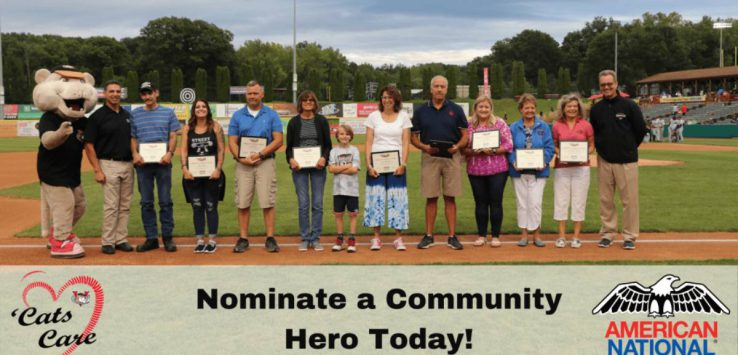 group of people on a baseball field with plaques