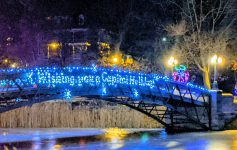 a bridge decorated with holiday lights
