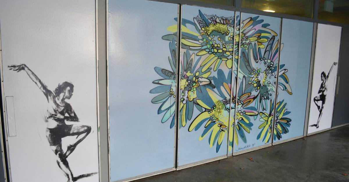 artworks of dancers and floral design on doors