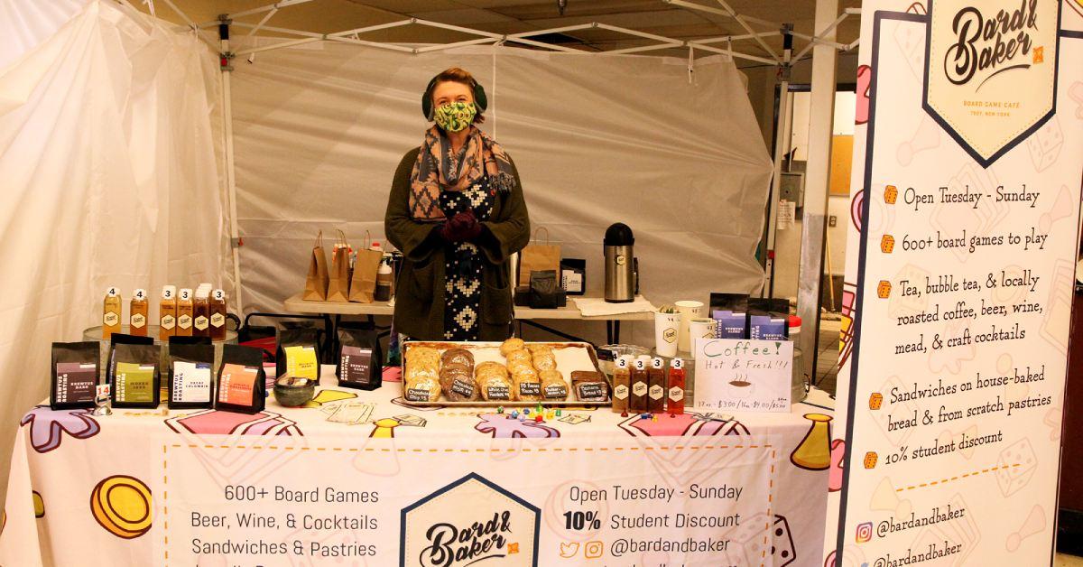 woman behind vendor table
