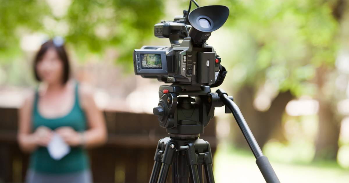 camera facing woman in background