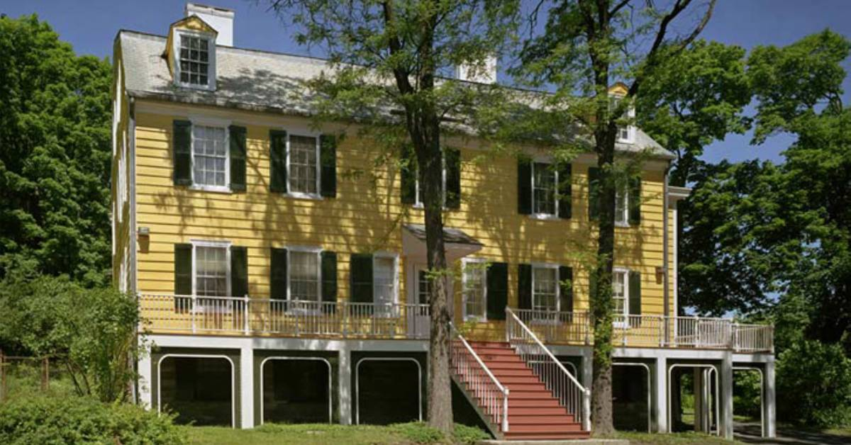 historic home with yellow exterior