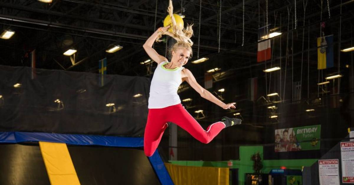 woman jumping on trampoline indoors