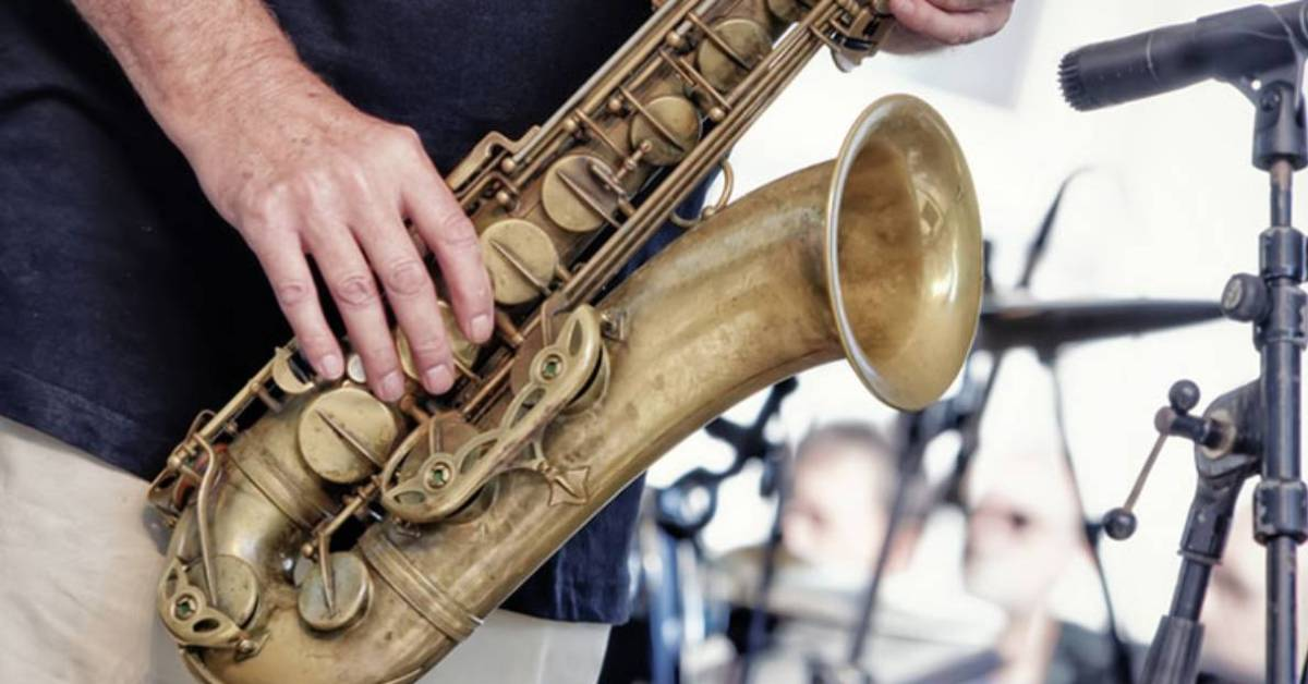 person playing the sax