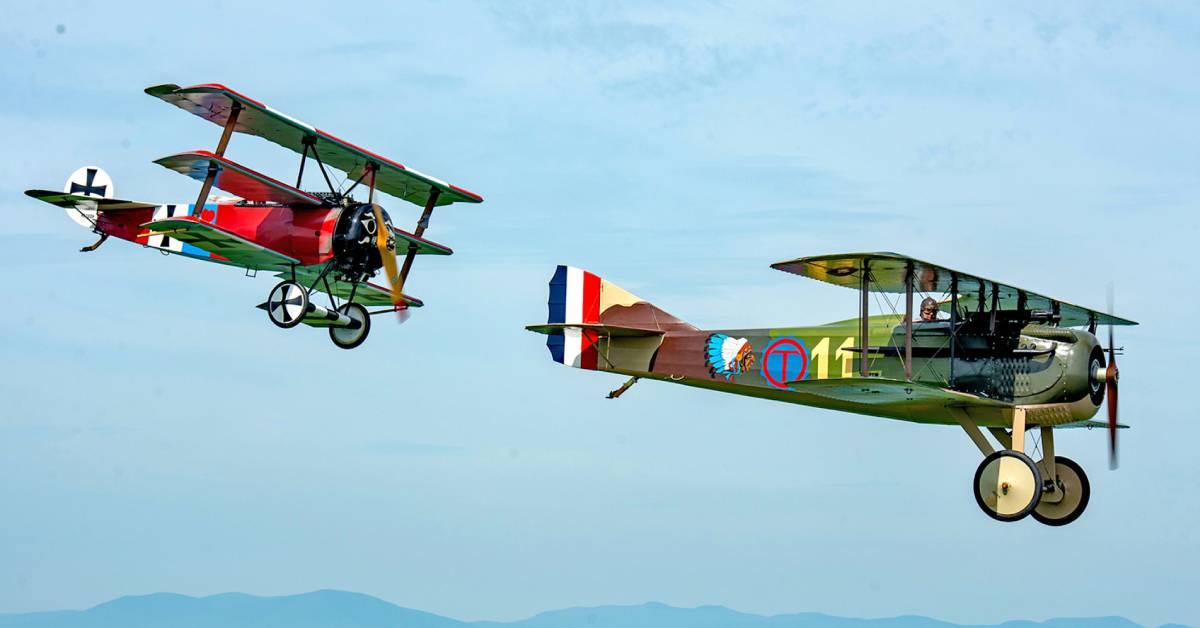 two old airplanes flying