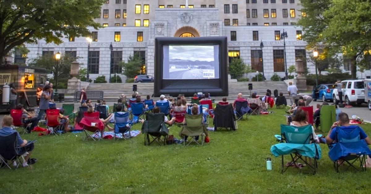 people watching movie outdoors