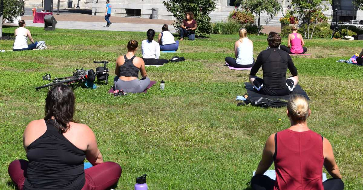 people at outdoor yoga class