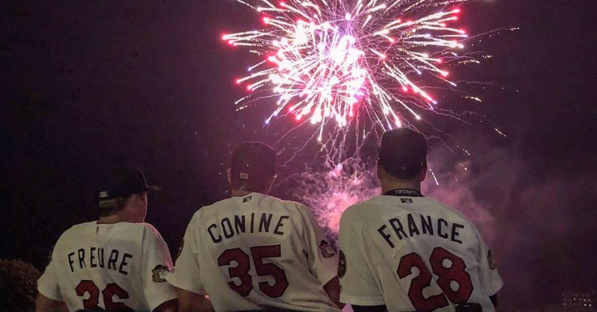 baseball players watch fireworks