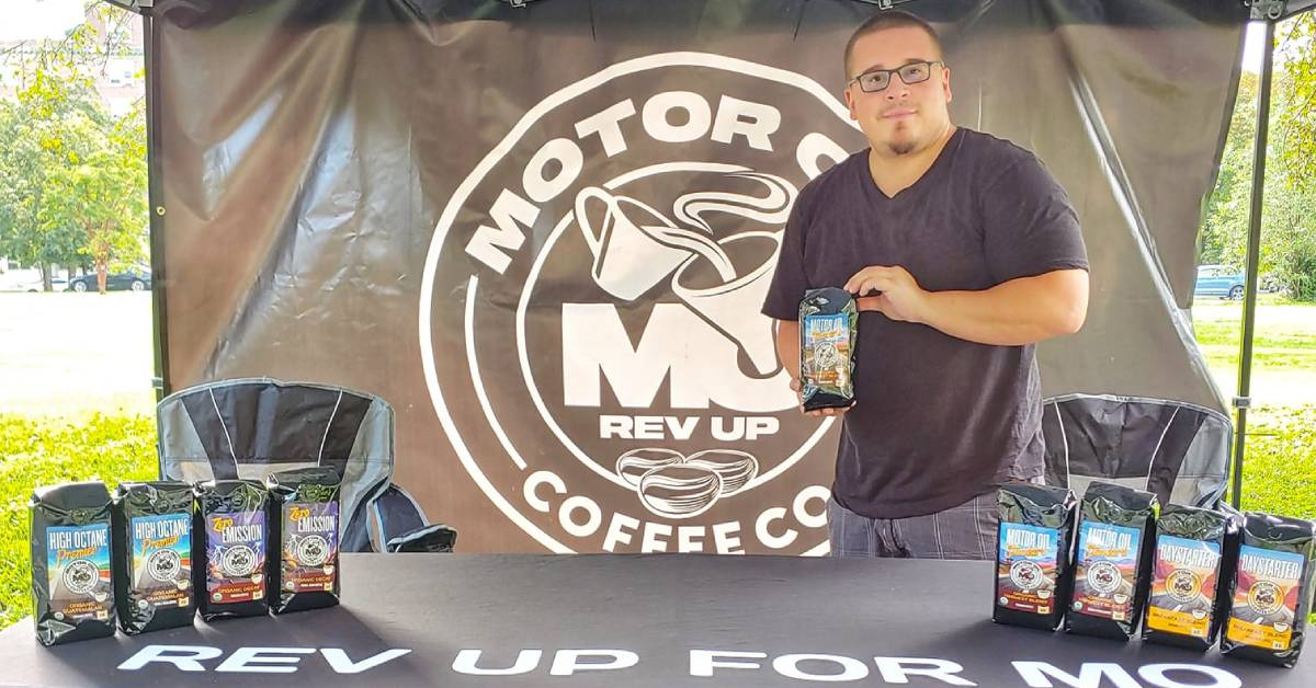 man at table featuring motor oil coffee brand