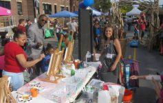 people at an outdoor street fair